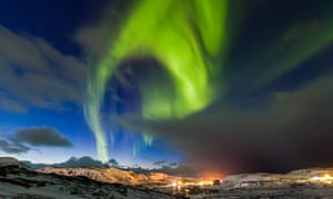 Northern lights over snow-capped mountains in Murmansk