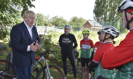 Boris Johnson meets members of a local cycling club in Beeston, Nottinghamshire, as his government launches its new cycling initiative to help get people fitter.