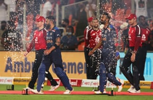 All fired up; Eoin Morgan and Jos Buttler make their way out alongside Virat Kohli and KL Rahul.