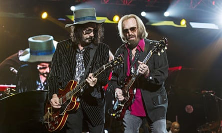 Mike Campbell and Tom Petty performing in 2017
