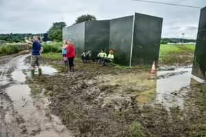 Waterlogged fields and paths greets early arrivals at Glastonbury