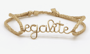 """""""Taking the biscuit are three gold bracelets inscribed with liberté, égalité and fraternité and selling for €250 each."""""""