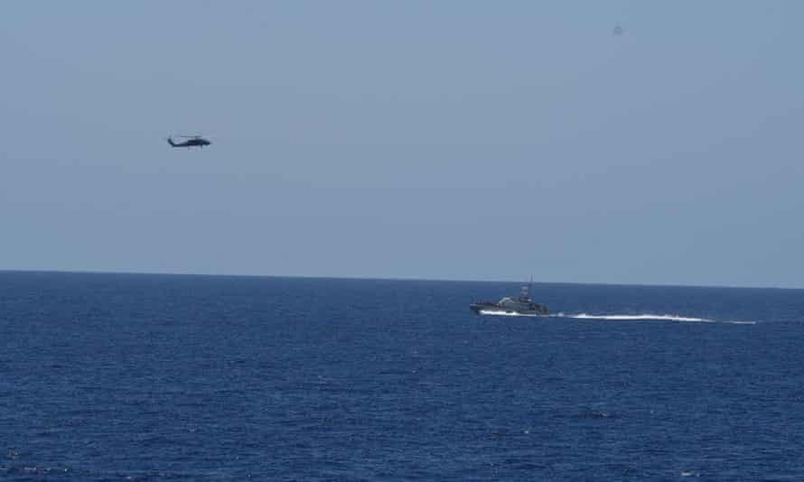 A helicopter and a boat at sea