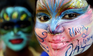 Students with their faces painted at a college in Chennai, India, on the eve of International Women's Day.