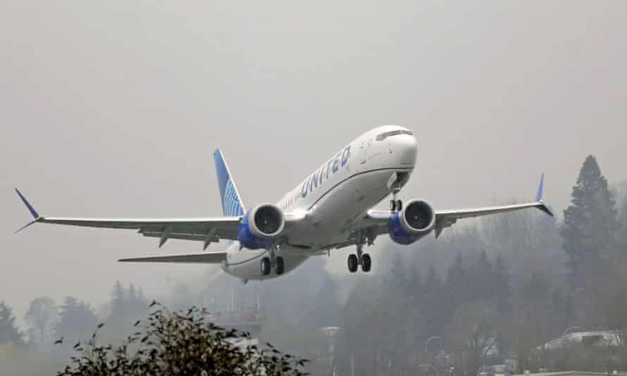 A United Airlines Boeing 737 Max airplane takes off in the rain at Renton Municipal Airport
