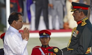 President Maithripala Sirisena (L) confers the honorary military rank of Field Marshal on Sarath Fonseka in March 2015 at a ceremony in Colombo.