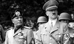 Benito Mussolini and Adolf Hitler attend a military parade together with high officials of the Wehrmacht in 1937