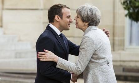 Emmanuel Macron greets Theresa May