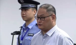 Taiwanese activist Lee Ming-cheh appearing in court in Yueyang in China's central Hunan province.