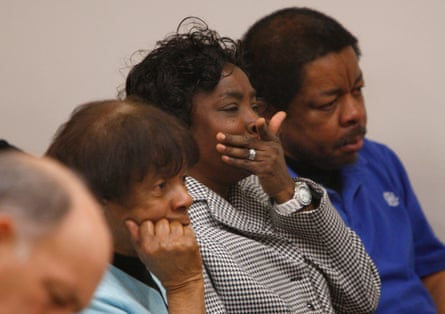 Shirley Burns, center, mother of Marcus Robinson, listens in court.