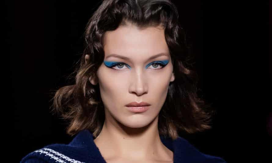 A model with indigo winged eyeliner and blue eyeshadow