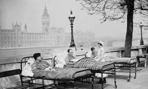 Tuberculosis patients from St Thomas' hospital rest in their beds by the River Thames in May 1936