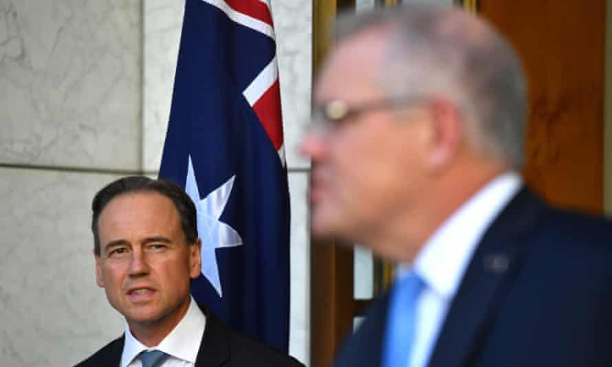 Minister for Health Greg Hunt (L) and Australian Prime Minister Scott Morrison (R) speak to the media during a press conference regarding coronavirus, in Canberra, Australia, 15 May 2020.