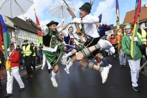 Herbstein, Germany: People in traditional costume enjoy the town's carnival parade