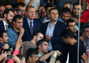 President Erdoğan surrounded by security and supporters as he arrives at Atatürk airport in Istanbul.
