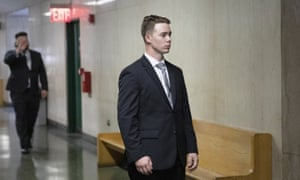 Maxwell Hare, center, and John Kinsman, back left, arrive at court during their trial in New York. The members of the far-right Proud Boys have each been sentenced to four years in prison.