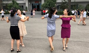 Women dance after voting in a local assembly election in Pyongyang, North Korea