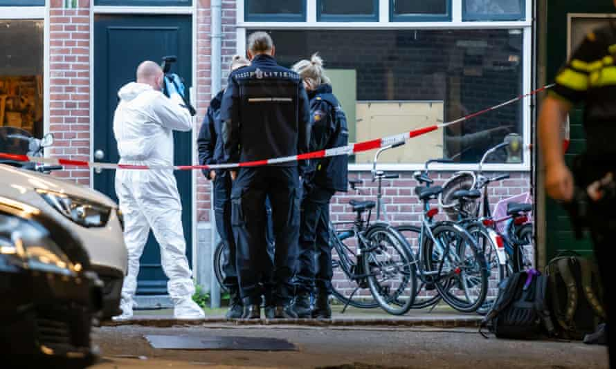Police officers investigate at the Amsterdam street where Peter de Vries was reportedly shot.