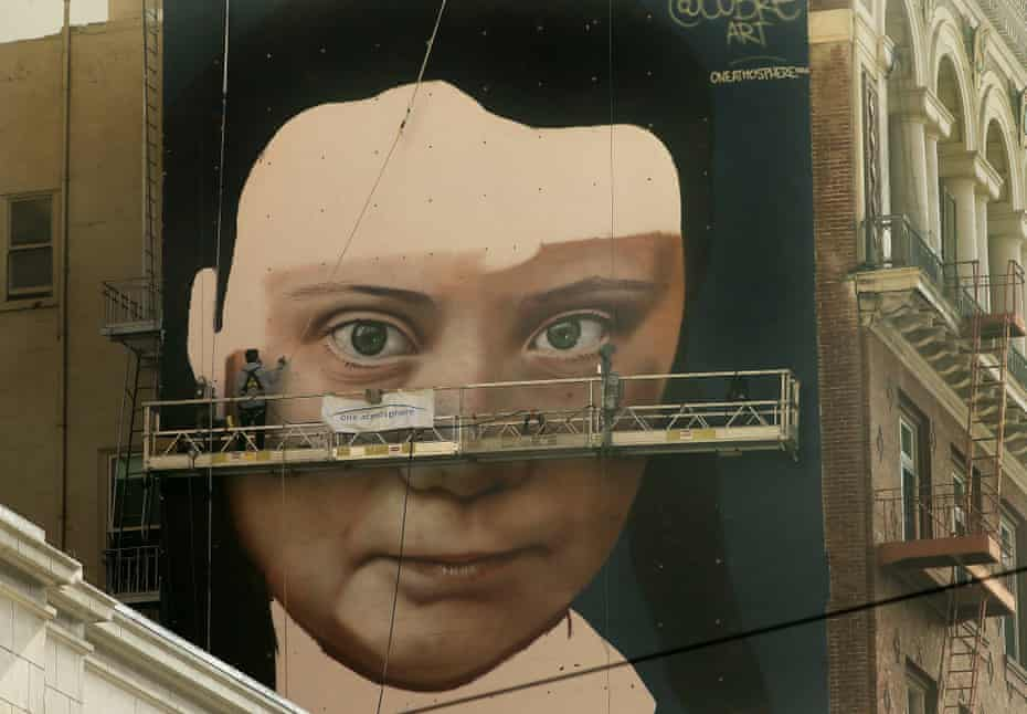 A mural on the side of a building depicts the Swedish teen climate activist Greta Thunberg.