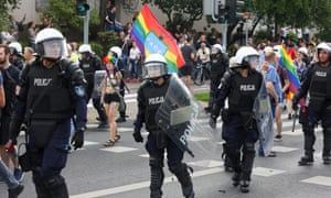 Riot police protect participants of the first equality march in the Polish city of Bialystok on 20 July.