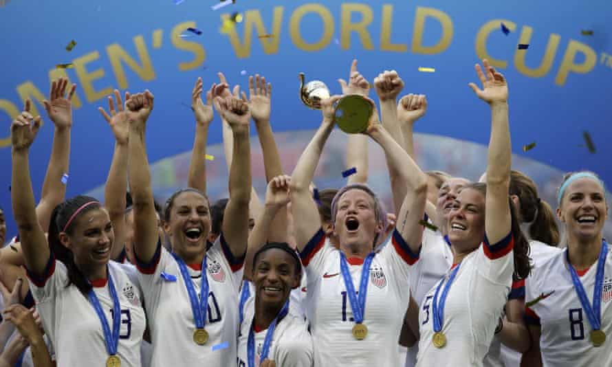 USA player Megan Rapinoe lifts the Women's World Cup in 2019.