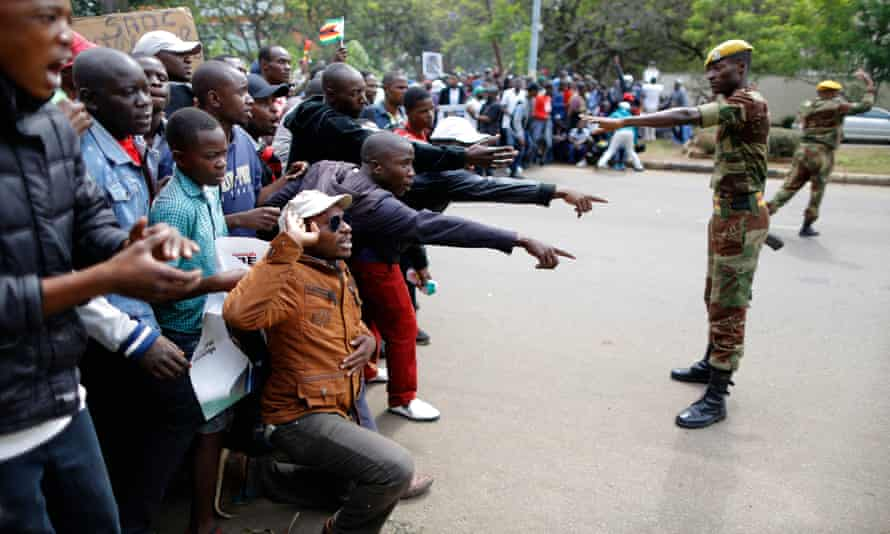 Soldiers stop people as they try to make their way to State House.
