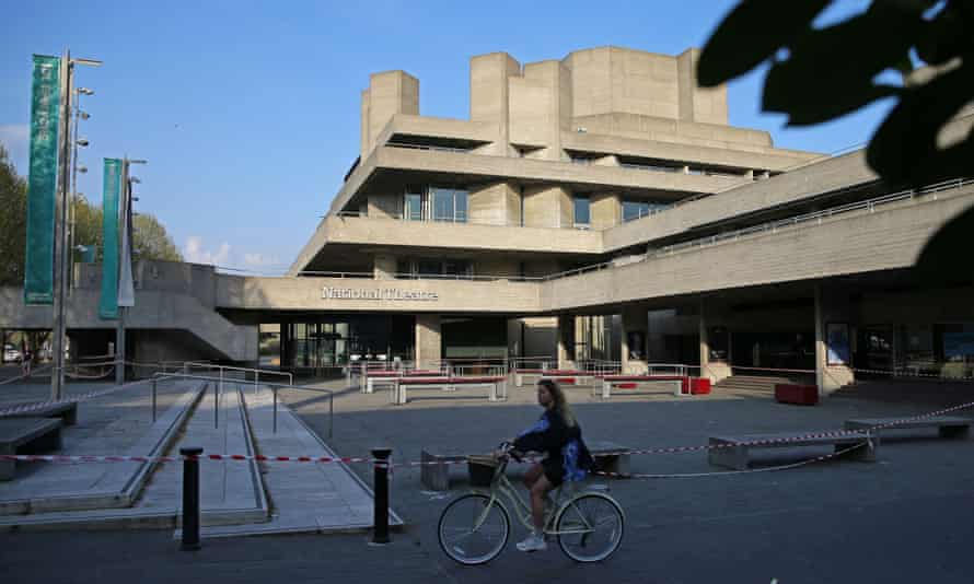 A cyclist rides past the National Theatre in London in April with its forecourt taped off to prevent use during lockdown.