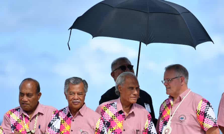 The leaders of Kiribati, Cook Islands, Tonga and Australia wait to pose for the family photo before the leaders retreat at the Pacific Islands Forum that caused divisions between Australia and other Pacific leaders.