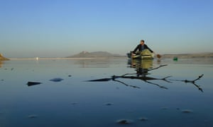 Fisherman on a boat on the Aghstafachai reservoir
