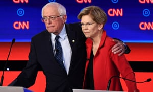 Bernie Sanders and Elizabeth Warren hug the second Democratic debate in Detroit.