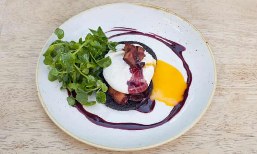 Black pudding, 'dotted with pearls of glistening fat', poached egg and lardons