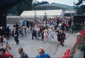 Excited spectators run into the Wimbledon grounds as the gates are opened in 1971