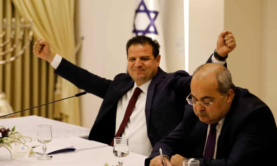 Joint List leader Ayman Odeh, left, after announcing the alliance's decision.