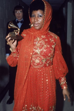 Holding one of her many Grammy awards, circa 1970