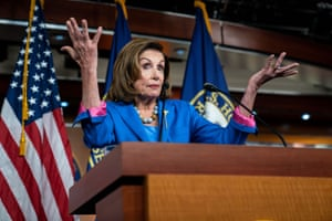 Nancy Pelosi attends her weekly press conference.