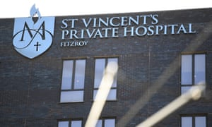 brown brick building with rectangle windows and St Vincents Private hospital sign in blue