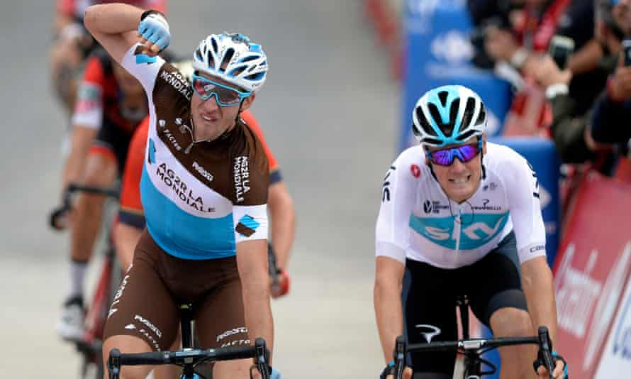 French cyclist Alexandre Geniez celebrates a tight victory over Team Sky's Dutch cyclist Dylan Van Baarle in the Vuelta on Thursday.