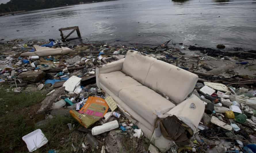 Sofa and rubbish on shores of Guanabara Bay