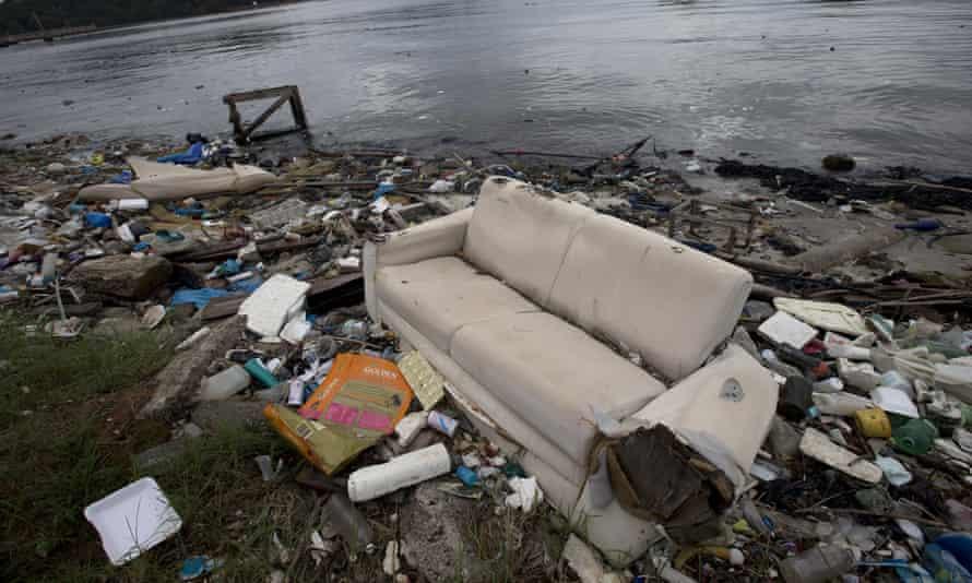 A discarded sofa litters the shore of Guanabara Bay in Rio de Janeiro, Brazil