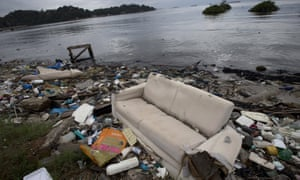 A discarded sofa is among the rubbish on the shore of the polluted Guanabara Bay in Rio de Janeiro, a venue for the 2016 Olympics