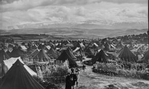 Palestinian refugees walk through the Nahr el-Bared refugee camp in Lebanon in 1952 (AP Photo/S.Madver, UNRWA Photo Archives)