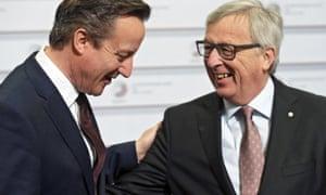 European Commission president Jean-Claude Juncker speaks to David Cameron before the Eastern Partnership summit in Riga.