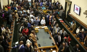 Members of Parliament gather to begin proceedings to impeach Zimbabwean President Robert Mugabe in Harare
