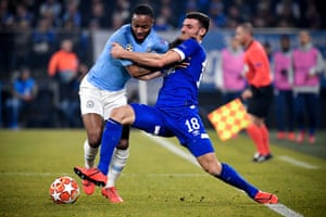 Shalke Daniel Caliguri (right) fights with Rahim Sterling from Manchester City.