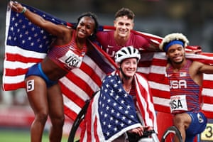 Mayhugh celebrates with his teammates Brittni Mason (left), Tatyana McFadden (front centre) and Noah Malone celebrate after winning gold and setting a new world record in the 4x100m universal relay final.
