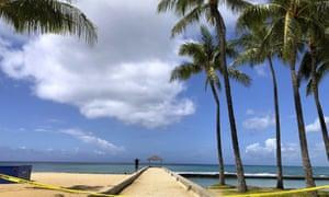 A man walks along a closed pier on Waikiki Beach in Honolulu in late March.