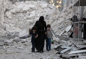 A family leaves the area following an airstrike