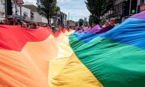 The giant rainbow flag makes its way towards Preston Park