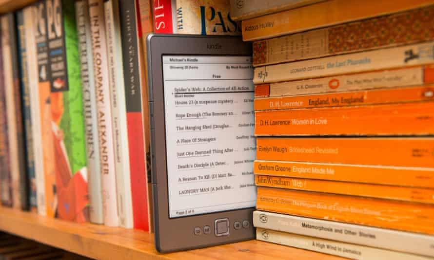 An Amazon Kindle in a bookshelf