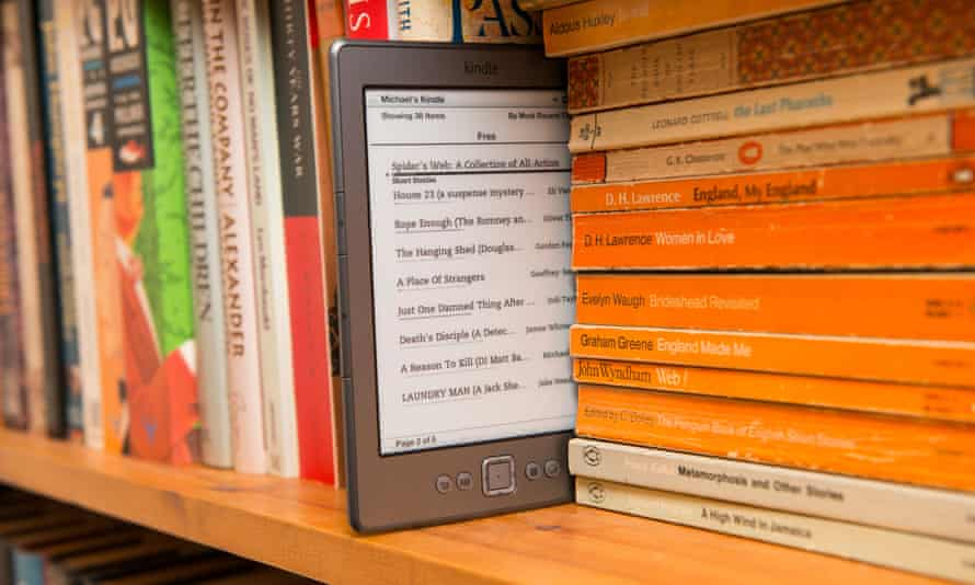 An Amazon kindle in a bookshelf.